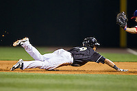 Gorkys Hernandez (9) of the Charlotte Knights dives back to first base during the game against the Buffalo Bisons at BB&T Ballpark on May 9, 2014 in Charlotte, North Carolina.  The Knights defeated the Bisons 5-3.  (Brian Westerholt/Four Seam Images)