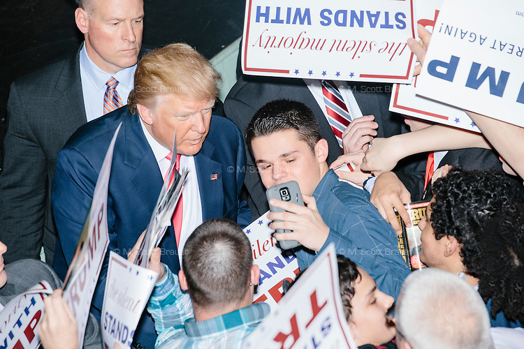 People crowd around to meet real estate mogul and Republican presidential candidate Donald Trump after he spoke at a rally at Exeter Town Hall in Exeter, New Hampshire, on Thurs., Feb. 4, 2016.