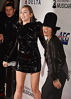 LOS ANGELES, CA - FEBRUARY 08: Miley Cyrus (L) and Linda Perry attend MusiCares Person of the Year honoring Dolly Parton at Los Angeles Convention Center on February 8, 2019 in Los Angeles, California.<br /> CAP/ROT/TM<br /> &copy;TM/ROT/Capital Pictures