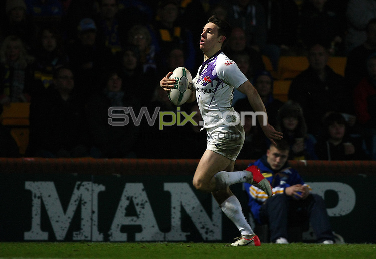PICTURE BY VAUGHN RIDLEY/SWPIX.COM - Rugby League - Super League - Leeds Rhinos v Salford City Reds - Headingley, Leeds, England - 15/02/13 - Salford's Niall Evalds runs the length of the pitch to score a try.