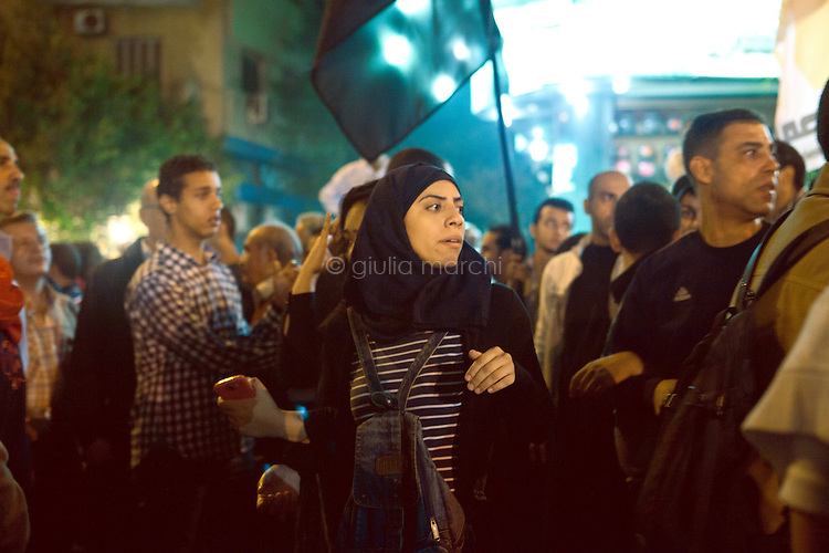 EGYPT / Cairo / 27.11.2012 / A protester during the march from the Shubra neighbourhood to Tahrir square, where thousands of people have gathered to protest President Morsi's above-the-law constitutional declaration. <br /> <br /> © Giulia Marchi