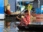 YOUNG WOMAN ON BOAT  IN CHONG KOS FLOATING VILLAGES AT TONLE SAP RIVER