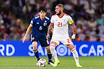 Seyed Ashkan Dejagah of Iran (R) fights for the ball with Endo Wataru of Japan (L) during the AFC Asian Cup UAE 2019 Semi Finals match between I.R. Iran (IRN) and Japan (JPN) at Hazza Bin Zayed Stadium  on 28 January 2019 in Al Alin, United Arab Emirates. Photo by Marcio Rodrigo Machado / Power Sport Images