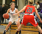 SIOUX FALLS, SD - DECEMBER 8:  Madi Robson #10 from the University of Sioux Falls looks to make a move against Alex Haley #20 from Minot State Friday night at the Stewart Center.(Photo by Dave Eggen/Inertia)