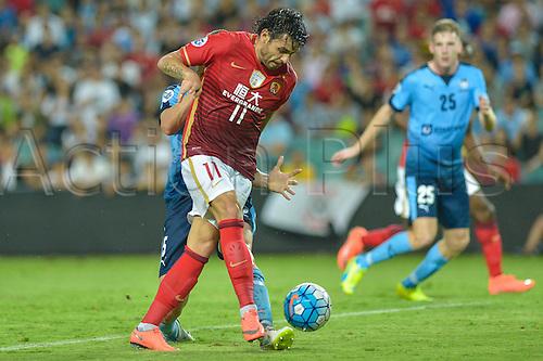 02.03.2016. Sydney, Australia. AFC Champions League. Sydney versus Guangzhou Evergrande. Evergrande midfielder Ricardo Goulart is first to a cross ahead of Sydney defender Matthew Jurman. Sydney won the game 2-1.