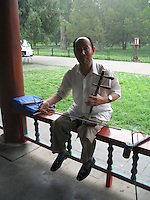 Man playing a traditional Chinese instrument
