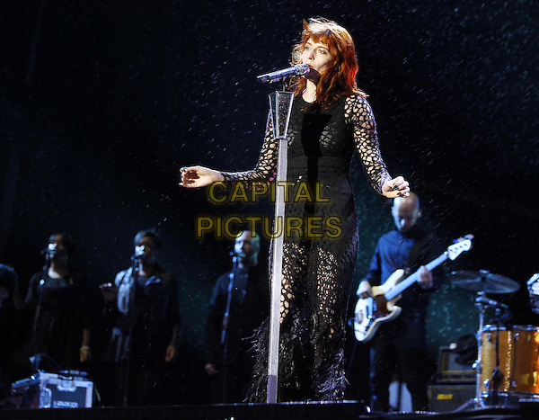 Florence Welch .Florence and the Machine at the Reading Festival 2012, Reading, Berkshire, England..August 25th 2012.on stage in concert live gig performance performing music half length black crochet dress singing hands arms full 3/4.CAP/JM/PP.©Jade Miranda/PP/Capital Pictures