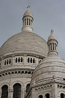 PARIS, FRANCE -  MAY 16 : A detail of the domes of Sacré Coeur, on May 16, 2008, in Montmartre in the 18th arrondissement of Paris, France. After the Franco-Prussian War in 1871, the basilica was built on the highest spot in Paris as an atonement and a symbol of national confidence. Designed by Paul Abadie, 1812-84, in a Romanesque-Byzantine style, the construction began in 1875 but was not completed until 1914, when the outbreak of the 1st World War delayed the official opening until 1919. Sacre Coeur is built of travertine stone which exudes calcium and always remains white, clearly seen here on a spring evening.  (Photo by Manuel Cohen)
