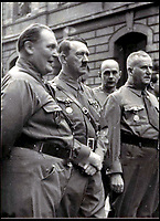 BNPS.co.uk (01202 558833)<br /> Pic:   Hansons/BNPS<br /> <br /> Ulrich Graf (left) with Adolf Hitler.<br /> <br /> A rare medal awarded to the man who 'changed the course of history' by saving Adolf Hitler's life is coming up for sale.<br /> <br /> Ulrich Graf was the bodyguard for the Nazi dictator at the time of the famous Beer Hall Putsch in Munich in November 1923.<br /> <br /> The revolutionary coup by the rising Nazi party to seize power in Bavaria resulted in a bloody battle with police, with 16 party members and four officers killed.<br /> <br /> Ulrich, a burly former wrestler, threw himself on Hitler and was shot five times but survived.<br /> <br /> Had he not done his job, Hitler could have been killed, the Nazis may never have come to power and the Second World War could have been avoided.