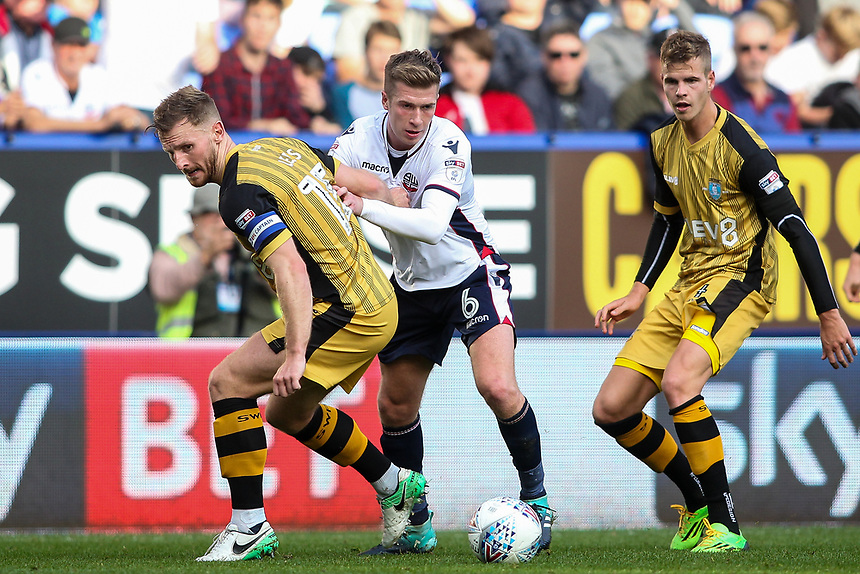 Bolton Wanderers'  Josh Vela competing with Sheffield Wednesday's Tom Lees <br /> <br /> Photographer Andrew Kearns/CameraSport<br /> <br /> The EFL Sky Bet Championship - Bolton Wanderers v Sheffield Wednesday - Saturday 14th October 2017 - Macron Stadium - Bolton<br /> <br /> World Copyright &copy; 2017 CameraSport. All rights reserved. 43 Linden Ave. Countesthorpe. Leicester. England. LE8 5PG - Tel: +44 (0) 116 277 4147 - admin@camerasport.com - www.camerasport.com