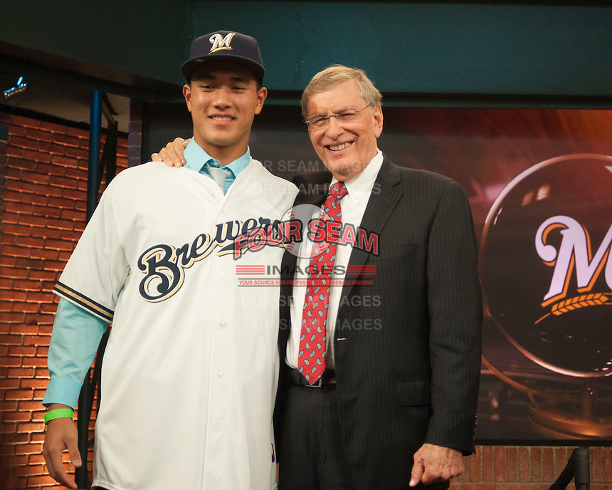 Pitcher Kodi Medeiros (Waiakea  H.S. (HI)) the number 12 overall pick to the Milwaukee Brewers with Commissioner Bud Selig during the MLB Draft on Thursday June 05,2014 at Studio 42 in Secaucus, NJ.   (Tomasso DeRosa/ Four Seam Images)