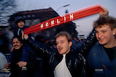 West Berlin, West Germany<br /> November 10, 1989<br /> <br /> An East German man holds up a sign that says Berlin in West Berlin. Germans gathered at the wall after the East German government lifted travel and emigration restrictions to the West the day before.