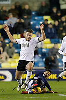 Lee Gregory of Millwall makes the tackle that lead to the third goal during the Sky Bet Championship match between Millwall and Sheff United at The Den, London, England on 2 December 2017. Photo by Carlton Myrie / PRiME Media Images.