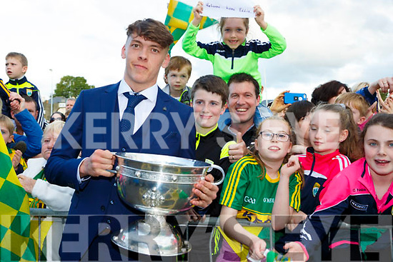 David Clifford captain of the Kerry minors  with Millie and Sean Hughes, Oran Daly and Aisling O'Connor at the homeing to Killarney on Monday evening