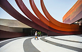 ISRAEL, Hulon, Design Museum by Ron Arad, a woman is walking outside