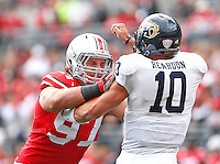 Ohio State Buckeyes defensive lineman Aaron Parry (91) puts pressure onKent State Golden Flashes quarterback Colin Reardon (10) in first half play at Ohio Stadium on September 13, 2014.  (Chris Russell/Dispatch Photo)