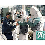 Police officers being fitted with gas masks and protective clothing before entering the Kasumigaseki Subway Station after the Sarin Gas Attack on March 20th, 1995 in Tokyo, Japan.  At around 8.00am in the morning members of the Aum Shirikyo Doomsday Cult released poisonous Sarin Gas in five coordinated attacks on trains travelling through Kasumigaseki and Nagatacho stations. This resulted in the death of 13 passengers and staff and over 6,000 injuries and was Japan's deadliest act of domestic terrorism. (Photo by Yomiuri Newspaper/AFLO)