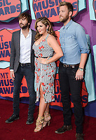 NASHVILLE, TN, USA - JUNE 04: Dave Haywood, Hillary Scott, Charles Kelley, Lady Antebellum at the 2014 CMT Music Awards held at the Bridgestone Arena on June 4, 2014 in Nashville, Tennessee, United States. (Photo by Celebrity Monitor)
