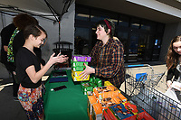 NWA Democrat-Gazette/J.T. WAMPLER Mary Kate Beck (RIGHT)of Fayetteville buys a stack of Girl Scout cookies from Kayleigh Fyke, 12, Sunday March 17, 2019 at the Walmart on Mall Ave. in Fayetteville. Fyke's goal is to personally sell 1000 boxes of cookies this season for Troop 5174. Next Saturday (3-23) her troop will be at the Neighborhood Market on Wedington Ave. in Fayetteville from 2 PM. to 8PM.