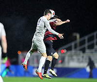 CARY, NC - DECEMBER 13: JB Fischer #8 of Georgetown University heads the ball over Zach Ryan #14 of Stanford University during a game between Stanford and Georgetown at Sahlen's Stadium at WakeMed Soccer Park on December 13, 2019 in Cary, North Carolina.