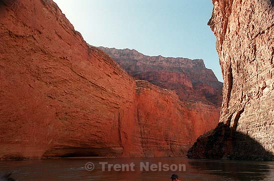 Canyon walls and rafter. Grand Canyon flood trip.<br />