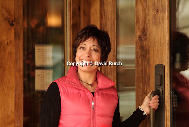 Hispanic woman entering a restaurant
