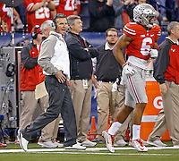 Ohio State Buckeyes head coach Urban Meyer yells for Ohio State Buckeyes wide receiver Evan Spencer (6) during the 2nd quarter of their game against Wisconsin Badgers in the 2014 Big Ten Football Championship Game at Lucas Oil Stadium in Indianapolis, Ind. on December 6, 2014.  (Dispatch photo by Kyle Robertson)