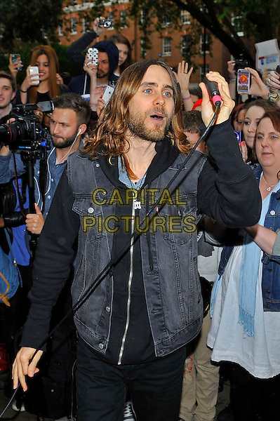 Jared Leto of 30 Seconds To Mars<br /> arriving for their flash mob gig, Soho Square, London, England, UK,  30th May 2013.<br /> performing concert live on stage half length music band group  black jacket levis denim microphone <br /> CAP/MAR<br /> &copy; Martin Harris/Capital Pictures