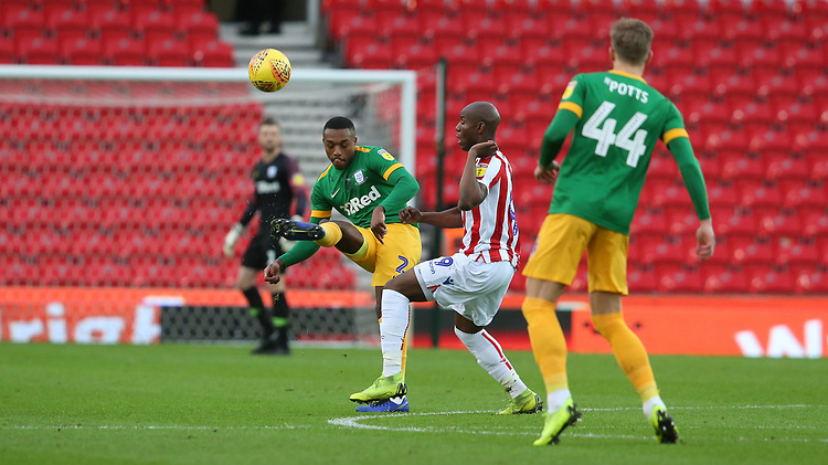 Preston North End's Darnell Fisher clears from Stoke City's Benik Afobe<br /> <br /> Photographer Stephen White/CameraSport<br /> <br /> The EFL Sky Bet Championship - Stoke City v Preston North End - Saturday 26th January 2019 - bet365 Stadium - Stoke-on-Trent<br /> <br /> World Copyright © 2019 CameraSport. All rights reserved. 43 Linden Ave. Countesthorpe. Leicester. England. LE8 5PG - Tel: +44 (0) 116 277 4147 - admin@camerasport.com - www.camerasport.com