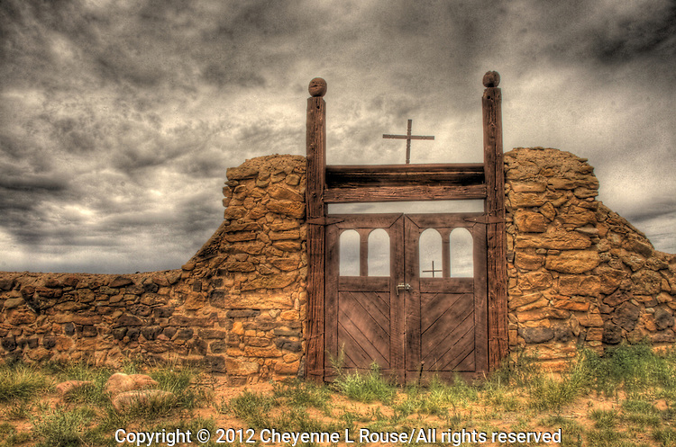 Cemetery gate with crosses in New Mexico on a gloomy day