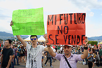 Mexican political protestors holding up signs at the Mexico Fest 2012 celebrations on Sept. 8, 2012 in Vancouver, British Columbia, Canada. These celebrations commemorated 202 years of Mexican Independence.