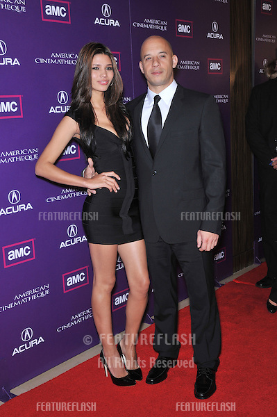 Vin Diesel & Paloma Jiménez at the 23rd American Cinematheque Award Ball at the Beverly Hilton Hotel..December 1, 2008  Beverly Hills, CA.Picture: Paul Smith / Featureflash