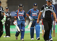 India's Gautam Gambhir and MS Dhoni walk off as rain halts play for the second time during the 2nd ODI cricket match between the New Zealand Black Caps and India at Westpac Stadium, Wellington, New Zealand on Friday, 6 March 2009. Photo: Dave Lintott / lintottphoto.co.nz