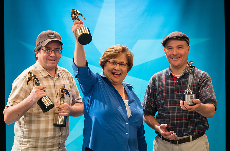 Houston ISD Multimedia Producers Robert Crowe, left, Debra Sanchez-Treese, center, and Raoul Rodriguez, right, display their 2017 Telly Awards, May 25, 2017.