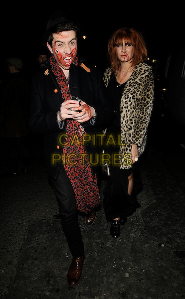 NICK GRIMSHAW & GUEST .At the Browns Focus Halloween Party, at the House of St. Barnabus, Soho, London, England, October 31st 2008..full length leopard print coat jacket bag red blood make-up .CAP/CAN.©Can Nguyen/Capital Pictures