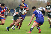 Gafatasi Su'a charges upfield towards Karl Ropati. Counties Manukau Premier Club Rugby game between Ardmore Marist and Manurewa, played at Bruce Pulman Park Papakura on Saturday May 12th 2018. Ardmore Marist won the game 20 - 3 after leading 17 - 3 at halftime.<br /> Ardmore Marist - Katetistoti Nginingini try, penalty try, Latiume Fosita conversion, Latiume Fosita 2 penalties.<br /> Manurewa - Logan Fonoti penalty.<br /> Photo by Richard Spranger.