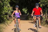 Beautiful summer day on the Zilker Park Hike And Bike Trail in Austin, Texas, two young people riding bikes.