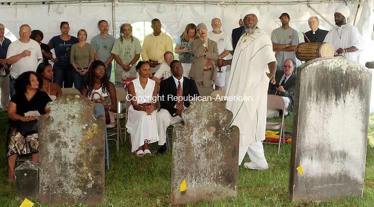 EAST HADDAM, CT-24July 2006-072406TK04- Abishai Ben Reuben Bey of Sounds of Africa peorlmed a Libation Ceremony over the grave of 18th centurey slave Venture Smith. Tom Kabelka Republican-American (Abishai Ben Reuben Bey)