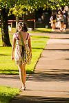 Female student walking on campus at University of Portland.