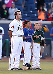 Reno Aces and local baseball players listen to the National Anthem before a game in Reno, Nev., on Saturday, April 18, 2015.<br /> Photo by Cathleen Allison