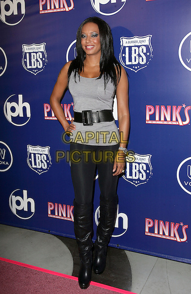 MEL B aka Melanie Brown.Pink's Hot Dogs Las Vegas Grand Opening at Planet Hollywood Resort Hotel and Casino, Las Vegas, Nevada, USA, 18th September 2009..full length grey gray top vest back waist belt leggings over the knee high boots hand on hip.CAP/ADM/MJT.©MJT/Admedia/Capital Pictures