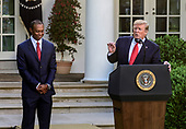 "United States President Donald J. Trump, right, makes remarks as he presents the Presidential Medal of Freedom to professional golfer Tiger Woods, left, in the Rose Garden of the White House in Washington, DC on May 6, 2019.  The Presidential Medal of Freedom is an award bestowed by the President of the United States to recognize those people who have made ""an especially meritorious contribution to the security or national interests of the United States, world peace, cultural or other significant public or private endeavor.""<br /> Credit: Ron Sachs / CNP"