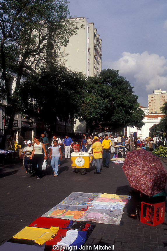 Crowds of people on a pedestrian walkway in downtown Caracas, Venezuela
