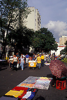 Crowds of people on a pedestrian walkway in downtown Caracas, Venezuela