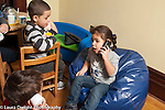 Education preschool 3-4 year olds two boys and a girl playing game together talking on telephones