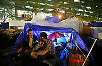 NewYork, United States, October 14, 2011..Protesters affiliated with the Occupy Wall Street movement, clean and pack their stuff before a call of the park's owner to clean Zuccotti park next Friday in New York October 14, 2011. VIEWpress /Kena Betancur..