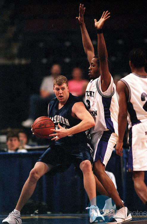 24 MAR 2001:  Forward Ryan Murphy (54) of Washburn University makes a post move against forward Thad Key (13) of Kentucky Wesleyan College during the NCAA Men's Division 2 basketball championship game held at Centennial Garden in Bakersfield, CA.  Kentucky Wesleyan defeated Washburn University 72-63.  Kirby Lee/NCAA Photos