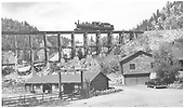 Fireman side view of RGS #74 crossing light at trestle 22-A with Green Mountain Ranch in foreground.<br /> RGS  Leonard, CO  Taken by Richardson, Robert W. - 9/25/1951