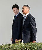 United States President Barack Obama, right, and Prime Minister Justin Trudeau of Canada, left, walk on the Colonnade to the Oval Office following an Arrival Ceremony on the South Lawn of the White House in Washington, DC on Thursday, March 10, 2016. <br /> Credit: Olivier Douliery / Pool via CNP