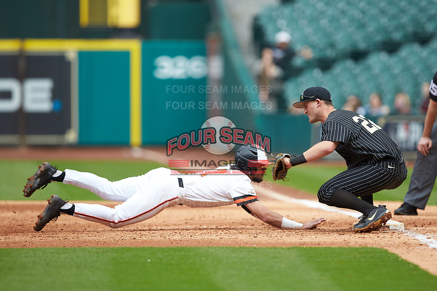 Andrew Fregia (7) of the Sam Houston State Bearkats dives back towards first base as Julian Infante (22) of the Vanderbilt Commodores receives a pick-off throw in game one of the 2018 Shriners Hospitals for Children College Classic at Minute Maid Park on March 2, 2018 in Houston, Texas. The Bearkats walked-off the Commodores 7-6 in 10 innings.   (Brian Westerholt/Four Seam Images)